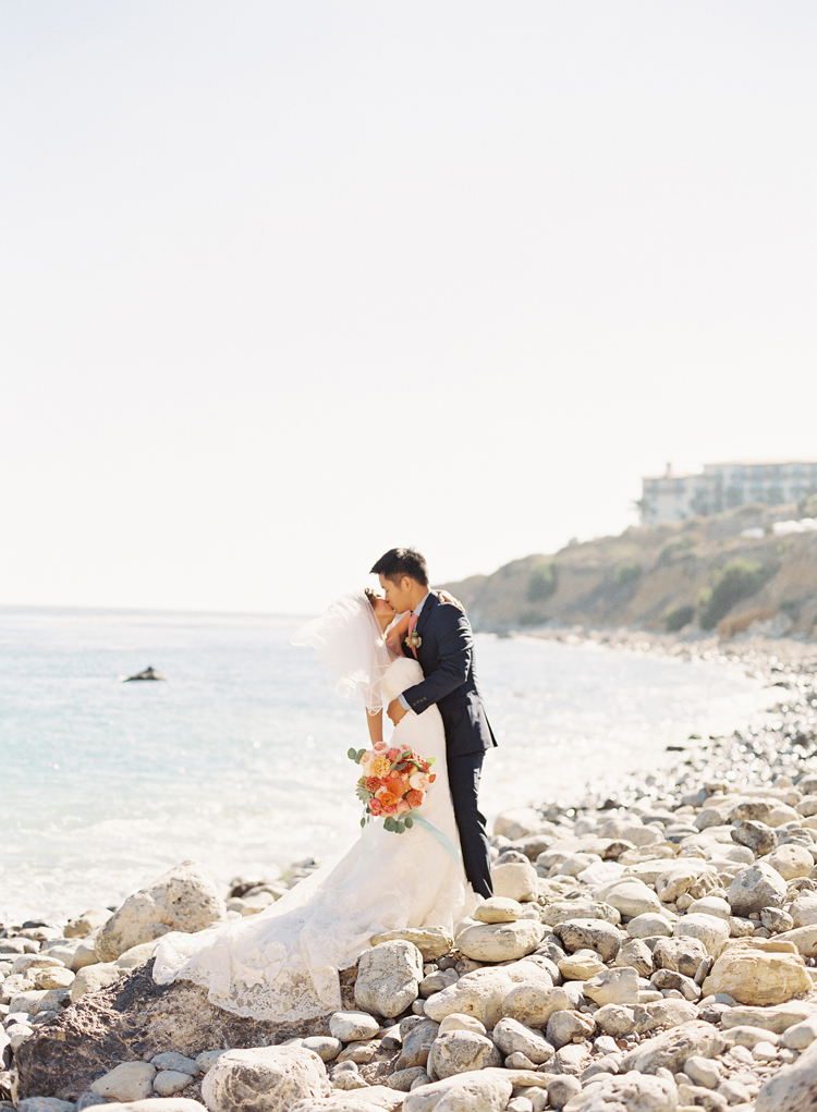 coral beach wedding photo by caroline tran