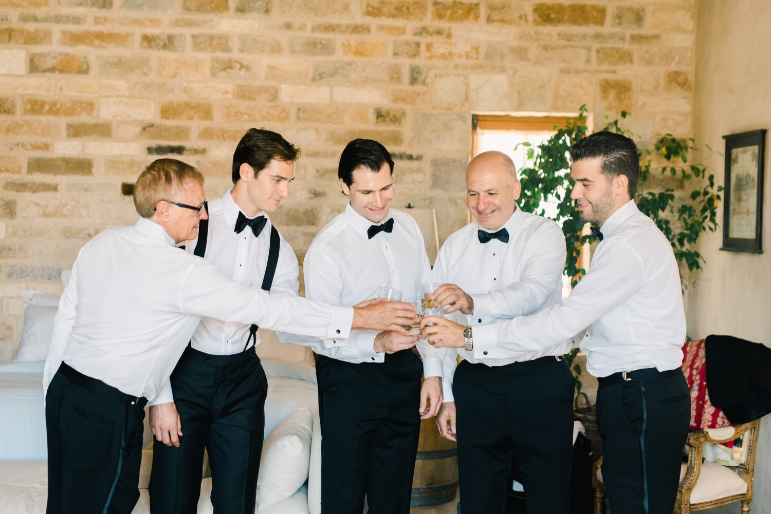 Groomsmen toasting with scotch before ceremony