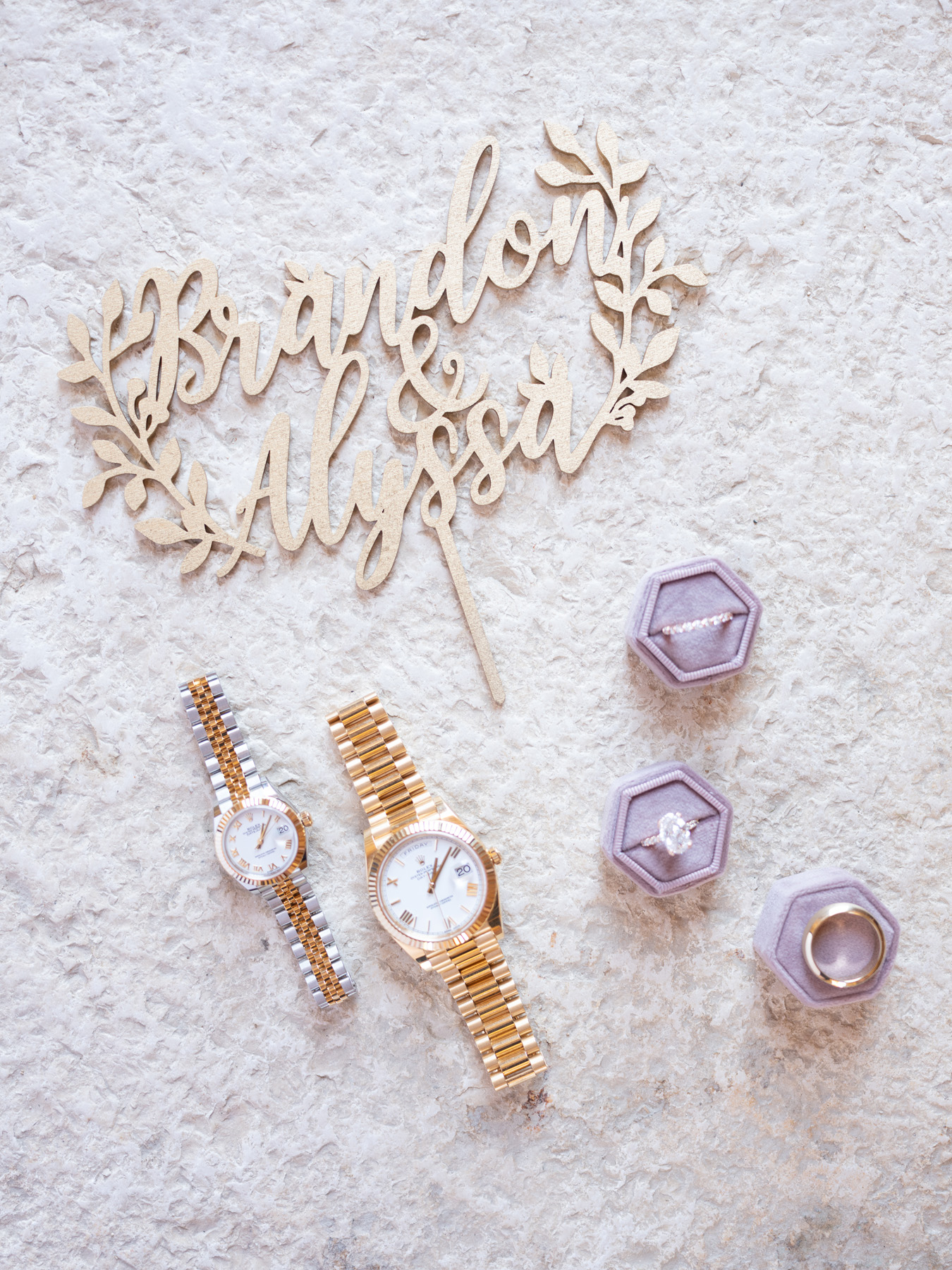 Overhead shot of the bride and groom matching watches and wedding rings