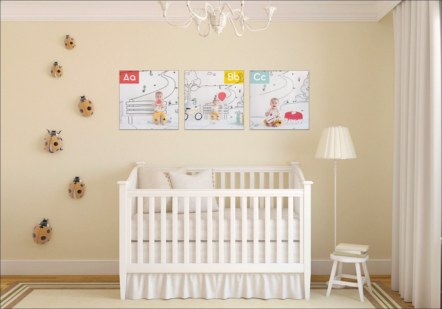 Photo of nursery with white crib and three ABCsons posters above the crib.