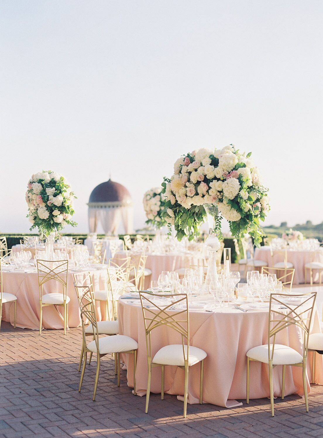 Outdoor wedding reception with round tablesettings