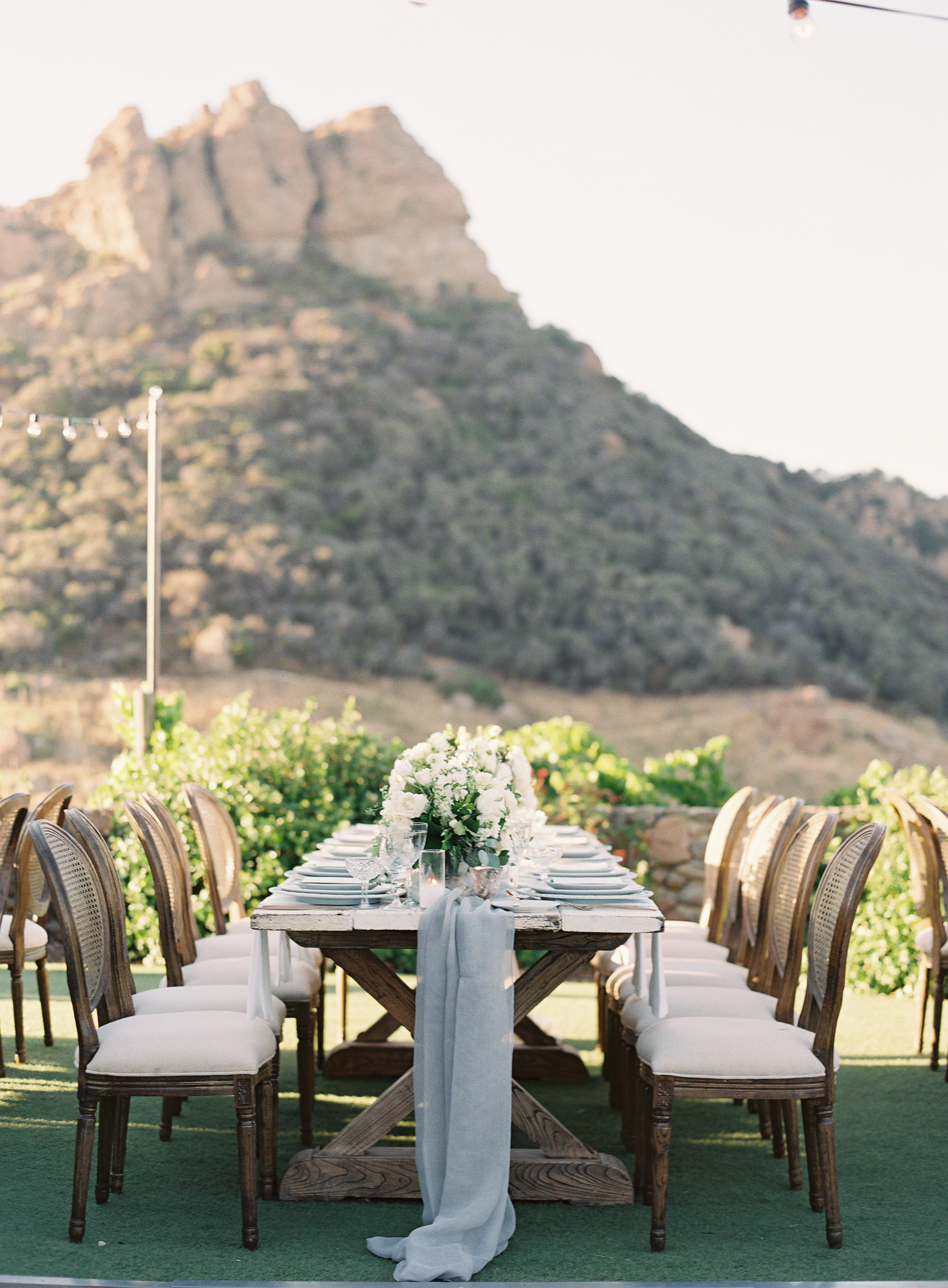 Farm style table setting with mountain int he background