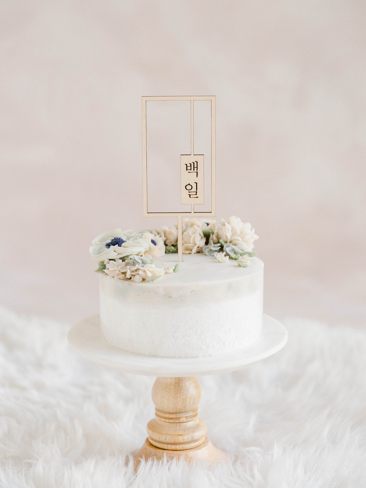 close up of 100 day cake on a cake stand