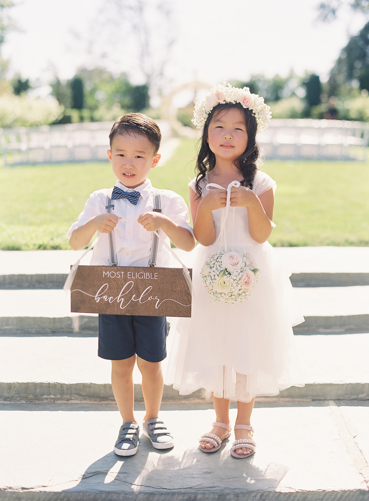 Ring bearer and flower girl standing side by side