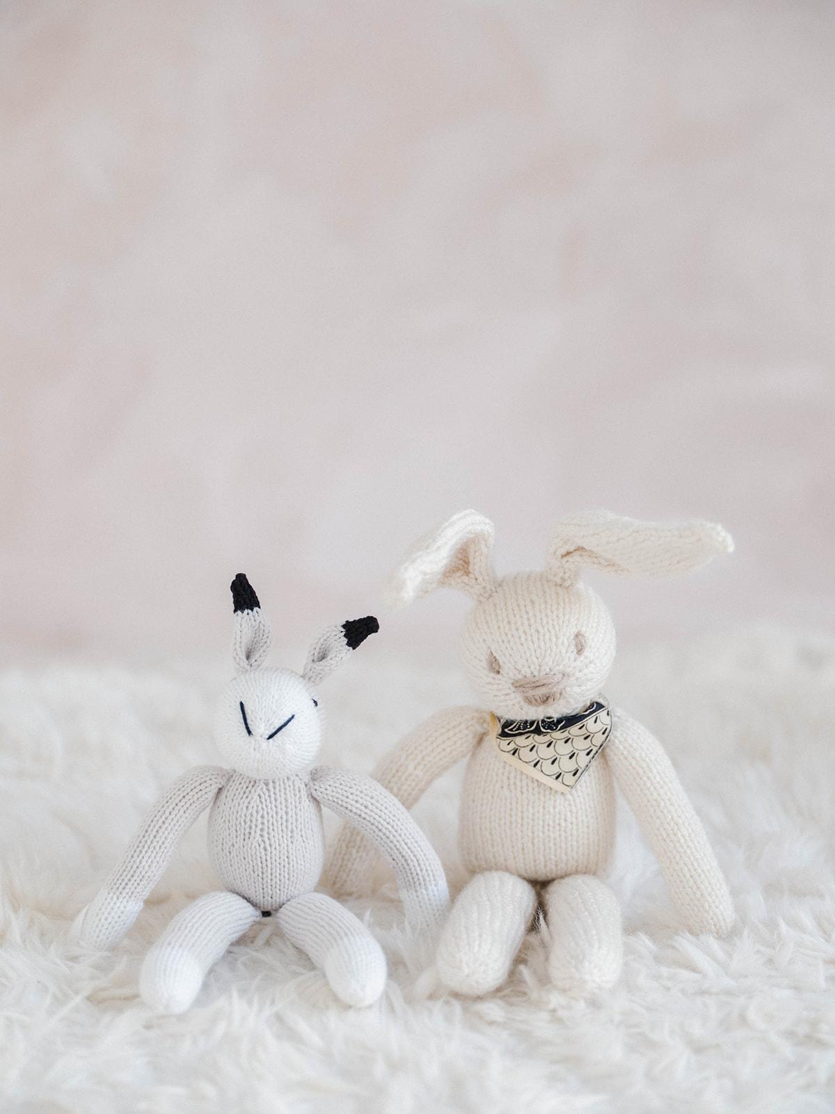 close up of handmade stuffed animal bunnies