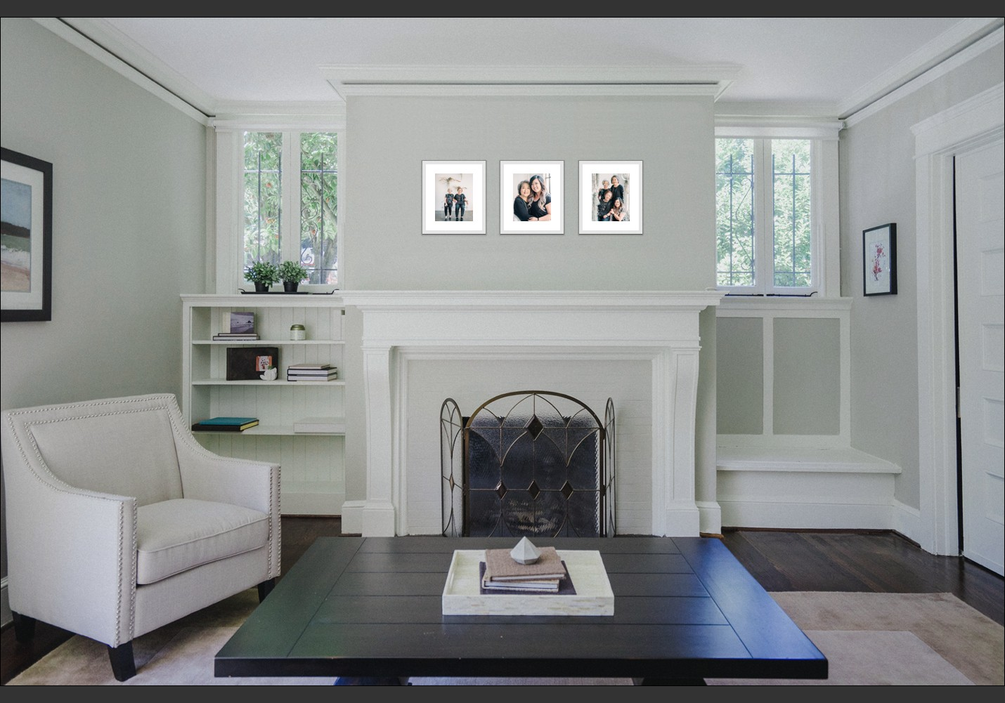Photo of fireplace with three photos displayed above it