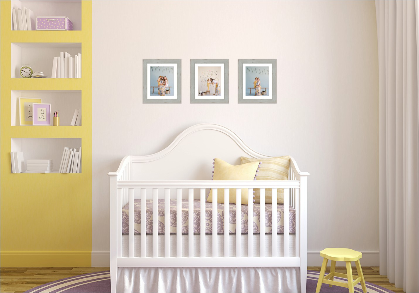 Photo of yellow nursery with three framed photos above the crib